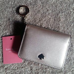 Kate Spade card holder in champagne gold colour.